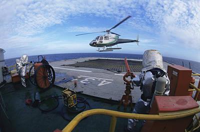 Drillship Photograph - Helicopter Landing On A Drillship by Alexis Rosenfeld