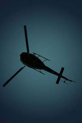 Photograph - Helicopter Silhouette by David Weeks