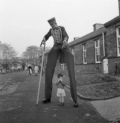 Henry The Stilt Man Art Print by John Drysdale