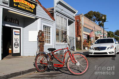 Historic Niles District In California.motorized Bike Outside Devils Workshop And Mercantile.7d12729 Art Print by Wingsdomain Art and Photography