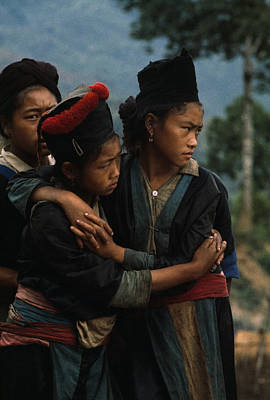 Hmong Girls Cling To Each Other Art Print by W.E. Garrett