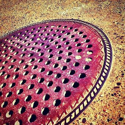 Cityscape Wall Art - Photograph - Holy Man Hole Cover by Christopher Campbell