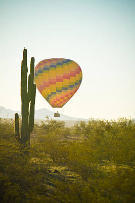 Photograph - Hot Air Balloon Over The Arizona Desert With Giant Saguaro Cactu by James BO  Insogna