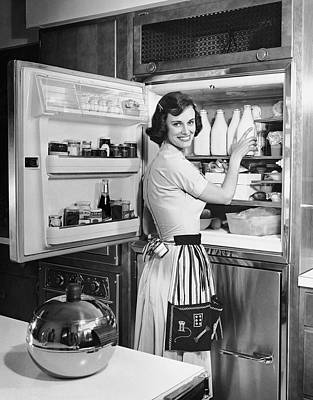 House Wife Removing Milk From Refrigerator Art Print by George Marks
