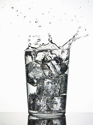 Water Splashing Photograph - Ice Cubes Splashing Into Fizzy Drink by Walter Zerla