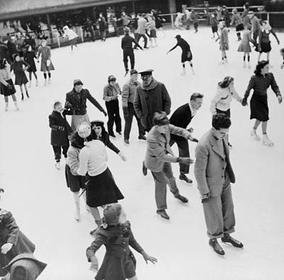 Ice Skaters At Rockefeller Center Print by Everett