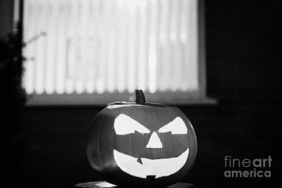 Illuminated Halloween Pumpkin Jack-o-lantern Outside The Window Of A House To Ward Off Evil Spirits  Art Print by Joe Fox
