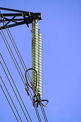 Insulators On An Electricity Pylon Art Print by Paul Rapson