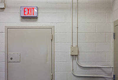 Interior Of A Prison Unit. Exit Sign Print by Roberto Westbrook