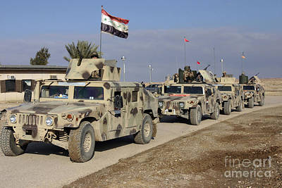 Iraqi Army Soldiers Aboard M1114 Humvee Art Print by Stocktrek Images