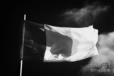 Fluttering Photograph - Irish Tricolour Flag With Frayed Edges Flying In Republic Of Ireland by Joe Fox