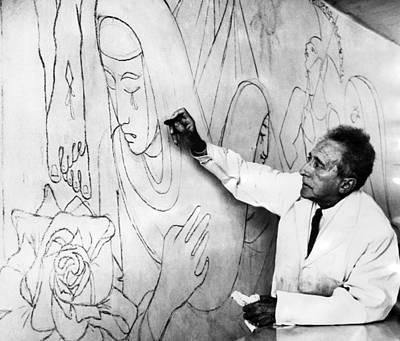 Jean Cocteau Photograph - Jean Cocteau Works On A Mural by Everett