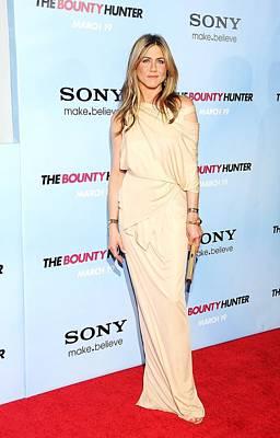 Bounty Hunter Photograph - Jennifer Aniston Wearing A Donna Karan by Everett