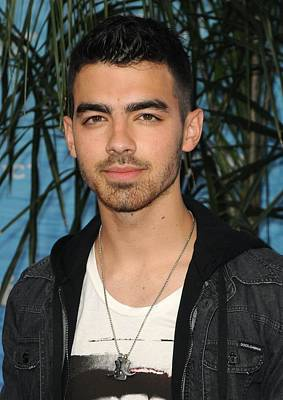Charm Necklace Photograph - Joe Jonas At Arrivals For Soul Surfer by Everett