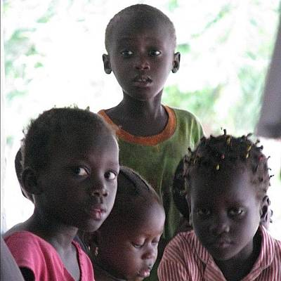 Expression Photograph - #kids #gambia #compound #sad #expression by Robin Boer