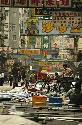 Kowloon Street With Workers Setting Print by Justin Guariglia