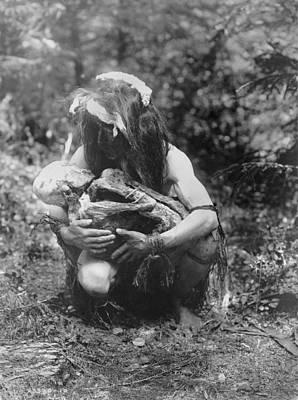 Kwakiutl Man, Crouched, Cradling Mummy Art Print by Everett