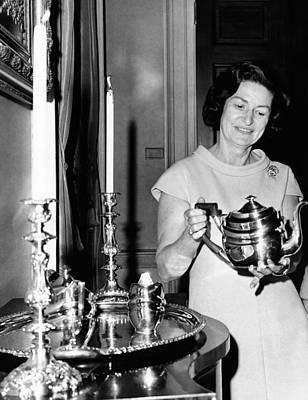 Lady Bird Johnson Holds A Silver Teapot Art Print