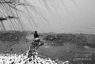 Photograph - Lake Fisherman In The Snow by Dean Harte