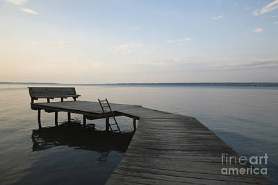 Lakeside Dock With Bench At Dusk Art Print by Roberto Westbrook