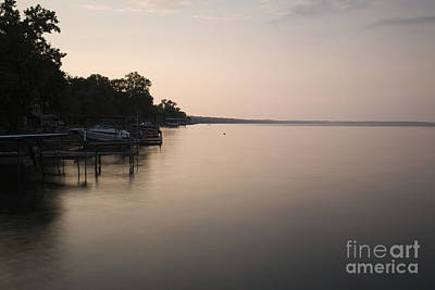 Lakeside Dock With Boat At Dusk Art Print by Roberto Westbrook