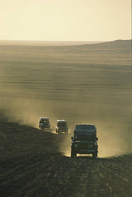 Land Rovers Kick Up Dust On The Old Print by Bobby Model