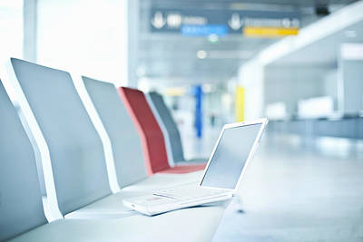 Laptop On Chairs In Airport Waiting Area Art Print by Cultura/Luc Beziat