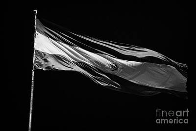 Flutter Photograph - Large Argentinian Flag Flying In The Wind Against A Blue Sky Republic Of Argentina by Joe Fox