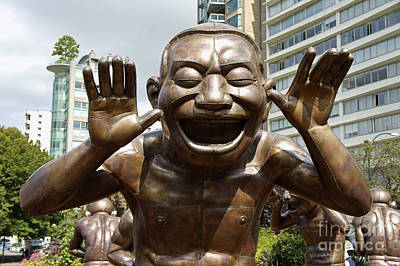 Photograph - Laughing Man Sculpture Vancouver Canada by John  Mitchell