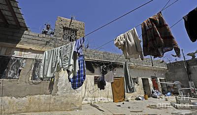 Laundry Hangs In The Courtyard Art Print by Stocktrek Images