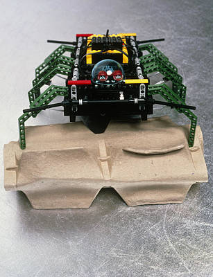 Lego Robot Spider Climbing Over A Box Print by Volker Steger