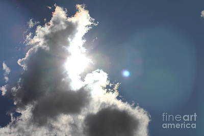 Photograph - Light Flare In Clouds by Donna L Munro