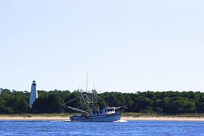 Lighthouse And Shrimp Boat Art Print by Ralph Jones