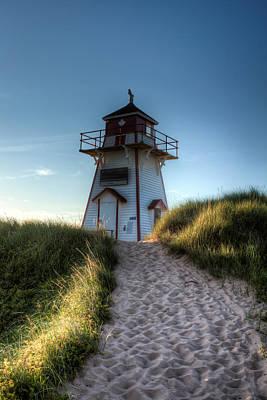 Lighthouse By The Sea Art Print by Matt Dobson