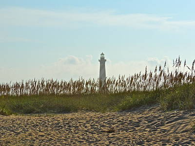 Photograph - Lighthouse From The Beach by Eve Spring
