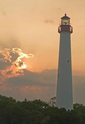 Lighthouse Sunset Art Print by Tom Singleton