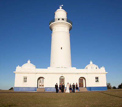 Photograph - Lighthouse Wedding Party by Carole Hinding