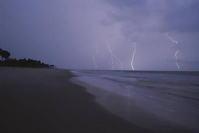 Gabon Photograph - Lightning Illuminates The Coastline by Michael Nichols