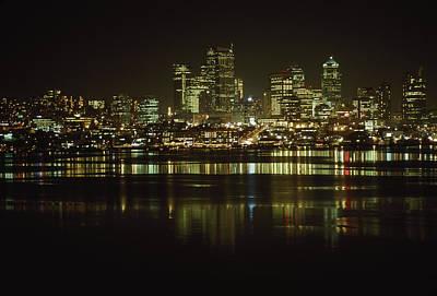 Lights Of Downtown Seattle Reflect Art Print by Gordon Wiltsie