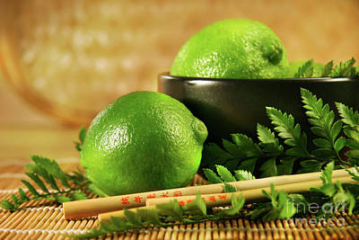 Limes With Chopsticks Art Print by Sandra Cunningham