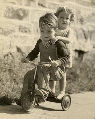Little Boy Giving Little Girl Ride On Tricycle Art Print by George Marks