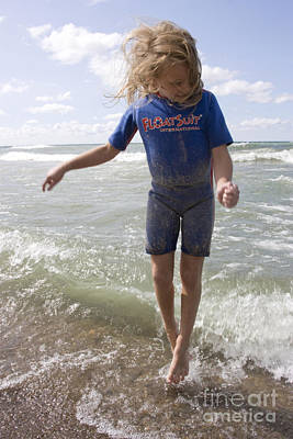 Little Girl Jumping In The Surf In Lake Michigan Art Print by Christopher Purcell