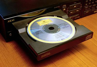 Compact Disc Photograph - Loading A Compact Disc Into Compact Disc Player by David Parker