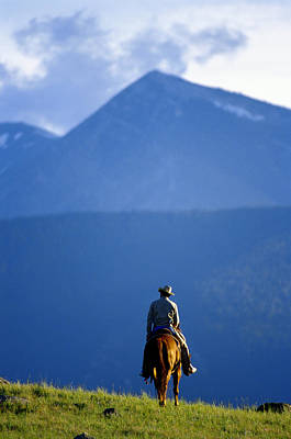 Working Cowboy Photograph - Lone Cowboy Riding The Range In Montana by John P Kelly