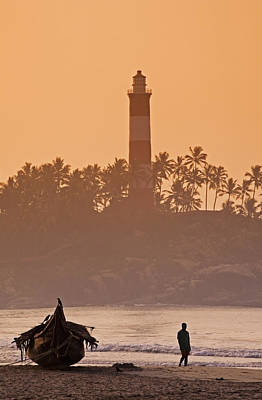 Lone Person Walking Along Lighthouse Beach In Early Morning Art Print by Anders Blomqvist