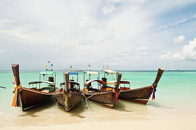 Clouds Over Sea Photograph - Longtail Boats At Phi Phi Island, Thailand by Melissa Tse