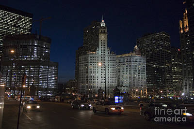 Speeding Taxi Photograph - Looking West And East Wacker Drive In Chicago At The Wrigley Building At Night by Christopher Purcell