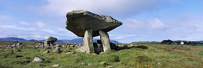Megalith Photograph - Low Angle View Of A Rock Structure by The Irish Image Collection