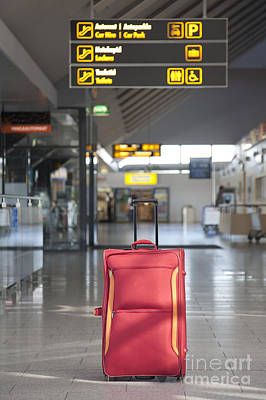 Rolling Luggage Photograph - Luggage Sitting Alone In An Airport Terminal by Jaak Nilson