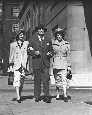 Man And Two Women Walking On Sidewalk, (b&w) Art Print by George Marks